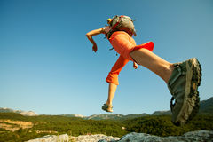 Hiker jumps Stock Photography