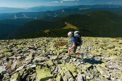 Hiker jumps Stock Image