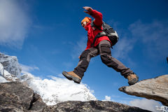 Hiker jumps on the rock near Everest in Nepal Stock Image