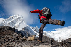 Hiker jumps on the rock near Everest in Nepal Stock Photography
