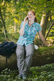 Hiker Keeping In Touch on Location Royalty Free Stock Photos