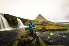 Hiker at Kirkjufell and Kirkjufellsfoss Royalty Free Stock Images