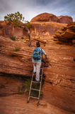 Hiker on the ladder Royalty Free Stock Photos