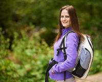 Hiker lady with backpack on trail Stock Photo