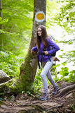 Hiker lady with backpack on trail Stock Images