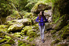 Hiker lady with backpack on trail Royalty Free Stock Photos