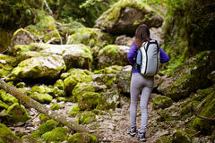 Hiker lady with backpack on trail Stock Image