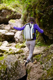 Hiker lady with backpack on trail Royalty Free Stock Photo