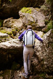 Hiker lady with backpack on trail Royalty Free Stock Image