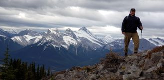 Hiker on Lady Macdonald mountain royalty free stock photography
