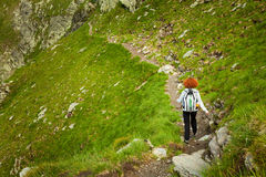 Hiker lady in mountains Royalty Free Stock Photos