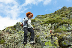 Hiker lady in mountains Royalty Free Stock Image