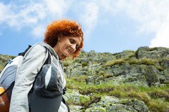 Hiker lady in mountains Stock Image