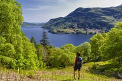 Hiker in Lake District. Female hiker looking at Lake Ullswater, Lake District National Park, Cumbria, England Royalty Free Stock Photos