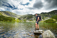 Hiker by the lakeside Stock Image