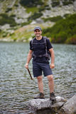 Hiker by the lakeside Stock Photo