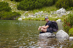 Hiker by the lakeside Royalty Free Stock Image