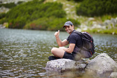 Hiker by the lakeside Stock Images