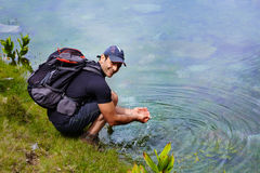 Hiker by the lakeside Royalty Free Stock Photos