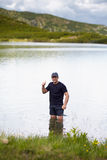 Hiker by the lakeside Stock Photography