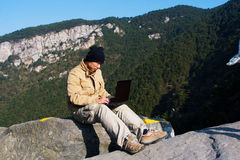 Hiker and laptop Stock Photography