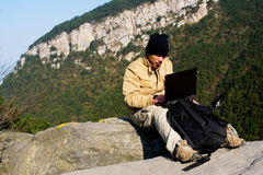 Hiker and laptop Stock Photos