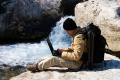 Hiker with laptop Stock Image