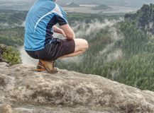 Hiker legs hiking in fall nature. Guy just relax on mountain top stock photos