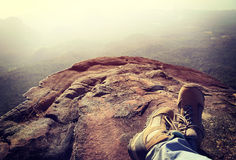 Hiker legs relax at mountain peak Stock Photography