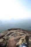 Hiker legs relax at mountain peak Stock Photo