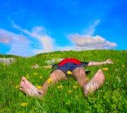 Hiker lies Stock Photography