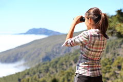 Hiker looking in binoculars Royalty Free Stock Images