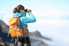 Hiker looking in binoculars Royalty Free Stock Image