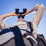 Hiker looking through binoculars on country trail Royalty Free Stock Image