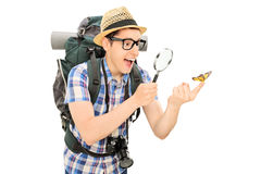 Hiker looking at a butterfly through a magnifier Stock Images