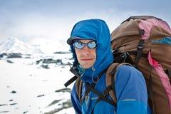 Hiker looking at camera Stock Image
