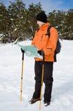Hiker looking at map Stock Image
