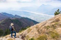 Hiker looking from Monte Chiampon to Friuli-Venezia Giulia Royalty Free Stock Photo