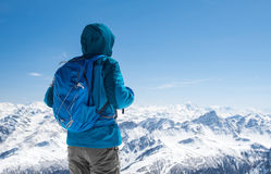 Hiker looking at snowy mountain Stock Photo