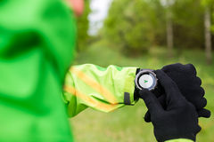 Hiker looking at sport gps smart watch Stock Photos