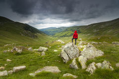 Hiker looking in to the distance. Stock Photos