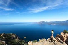 Hiker looking at Calanques de Piana in Corsica, France Stock Photo