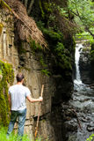 Hiker Looking at the Waterfall Stock Photos