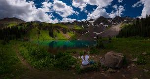 Hiker looks at Blue Lake Ridgway Colorado royalty free stock photos
