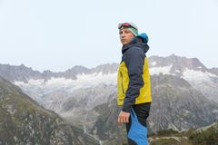 Hiker looks at the camera with a serious facial expression Stock Image