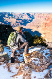 Hiker looks into depth of Grand Canyon before going on the trail Royalty Free Stock Image