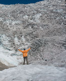 Hiker looks at icefall Royalty Free Stock Images