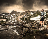 Hiker looks at Lake Isabelle Brainard Lake Recreation Area Royalty Free Stock Photos