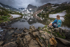 Hiker looks at Lake Isabelle Brainard Lake Recreation Area Royalty Free Stock Photo