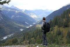 Hiker looks to river Royalty Free Stock Images